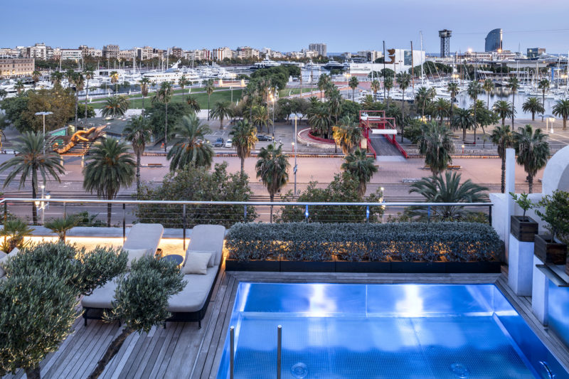 Hotel The Serras, Barcelona, Rooftop pool at sunset.